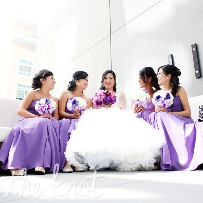 "Jen's four bridesmaids wore matching, floor-length Alfred Angelo bridesmaid dresses in purple. ""I made sure to get their full approval before selecting it!"" Jen says."