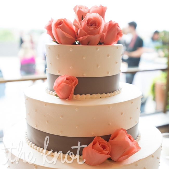 The wedding cake was three classic, round tiers decorated simply with gray ribbon bands and dots. Fresh pink roses topped it off.