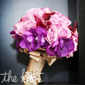 Pink roses and purple vanda orchids made up Jens pretty bridal bouquet. The stems were wrapped in gold ribbon and tied off with a daisy crystal accent (in honor of Jens mom, Daisy).