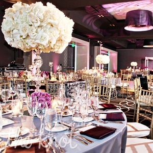 """We wanted the theme to be subtle yet romantic,"" Jen says. The room came together with soft purple linens and gold chiavari chairs."