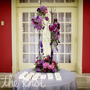 Denedra and Jeffrey's florist was able to continue the use of natural branches throughout their wedding day by creating tall centerpieces made of natural branches and an assortment of hydrangeas and calla lilies.