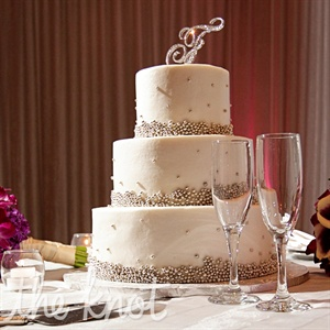 As Denedra walked into the bakery, she saw this three tier buttercream cake with edible silver spheres. Immediately she knew she had found her cake making it the easiest decision she had to make throughout the planning.
