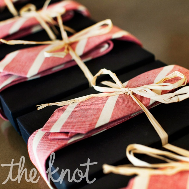 Scott wanted to give the groomsmen flasks as their gift and provided them with matching ties for the wedding. It was Meagan's idea to wrap the ties around the flasks.