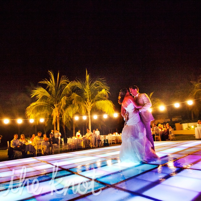 "They danced under the stars on the beach to oldies and hits but their first dance was to ""You are the best thing"" by Ray LaMontagne."