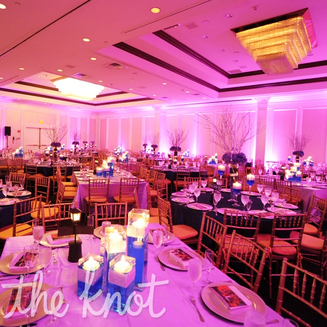 Sarena and Naitik used an assortment of rectangle tables for bridal party and families and alternated round and square tables for the remiaing guests.  Table linens also alternated between lavender and navy.