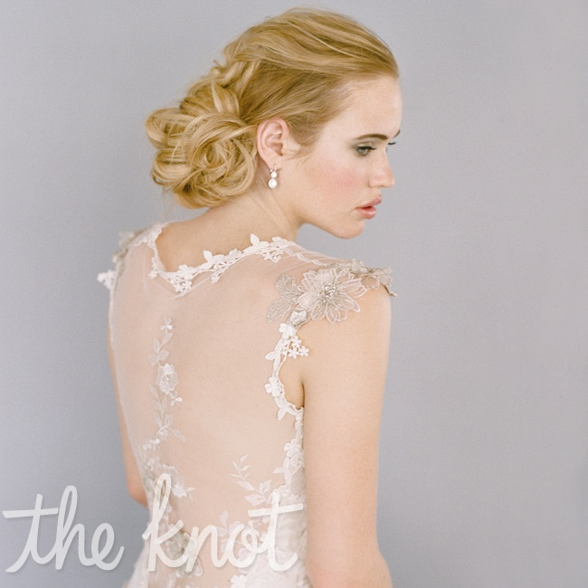 Reveal your natural color in a sheer back with metallic details. Gown by Claire Pettibone, $4, 825; earrings by Rahaminov for Forevermark, $51,310