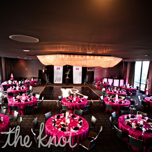 The reception took place on the 27th floor, Altitude Room, of the W Hotel, Midtown Atlanta, which provided guests with a beautiful panoramic view of the Atlanta skyline. The raspberry table linens stood out against the black décor throughout the reception room.