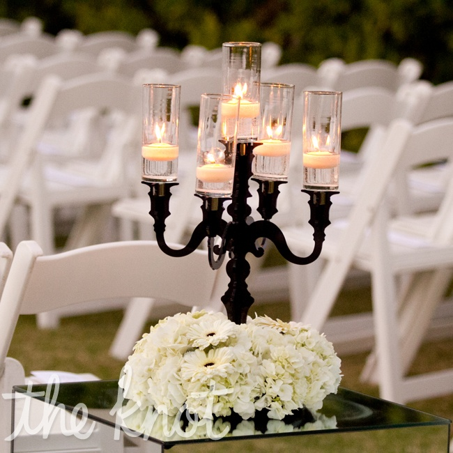 Vintage black candelabras and white daisies spotted the ceremony space.