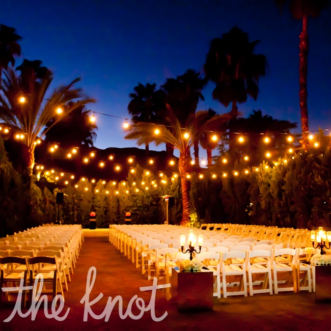 The romantic evening ceremony was lit with bistro lights hung overhead.