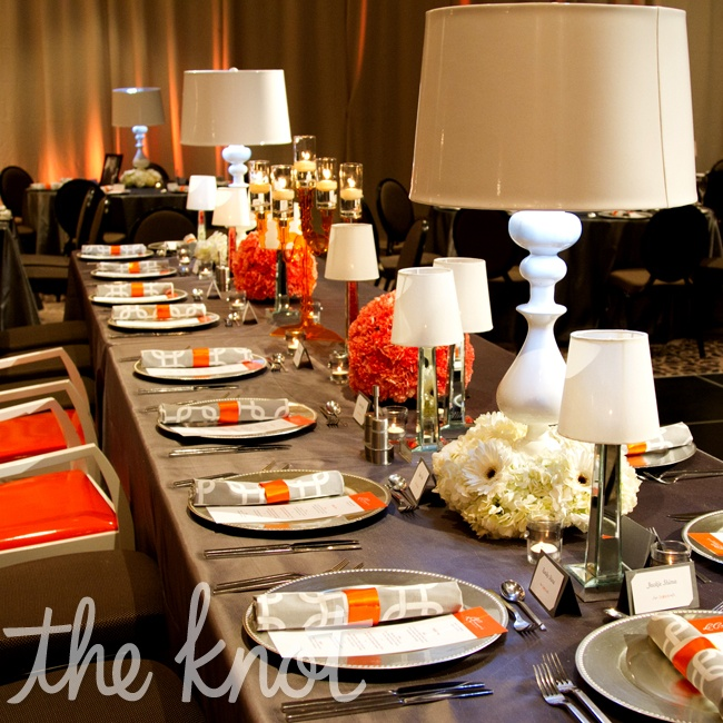 Mid-century modern lamps were the focal point at the long head table.