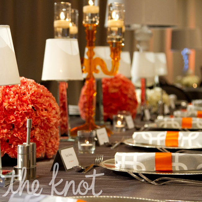 White gerbera daises and orange pomanders popped against the pewter linens.