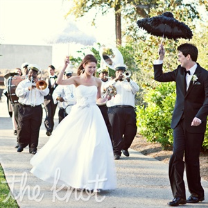 "After the ceremony ended, Tarah and Sean had a traditional New Orleans ""second line"" dance. Their guests, along with a brass band, followed them, waving white handkerchiefs. While the couple snuck off for photos, the band led the guests into the reception."