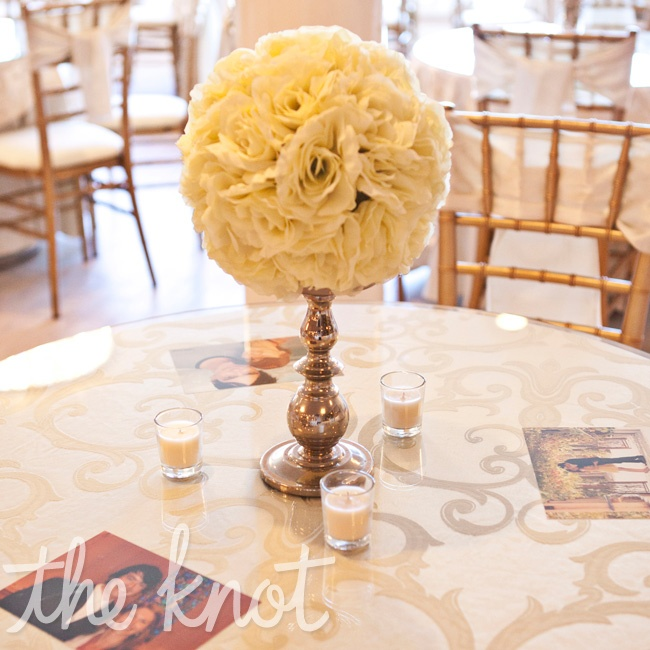 Tarah placed photos of her and Sean through the years beneath the glass on tables, and the silk flower centerpieces provided by the venue (a huge money-saver) were an elegant touch.
