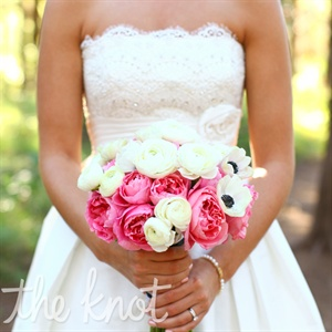 Lauren had originally wanted peonies for her bouquet, but they were out of season. Her florist found pink garden roses that fit the bill and mixed them with white anemones.
