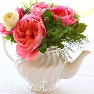 Lauren bought a mix of teapots on Etsy.com and had them filled with garden roses and greens to serve as simple but unique centerpieces.