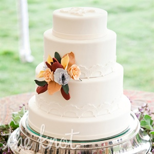 A colorful fondant flower decorated the simple, all-white cake.