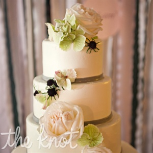 The cake consisted of vanilla butter cream frosting with layers of chocolate cake and fruit filling and  incorporated flowers that were used throughout the wedding. Lauren and Stephen chose a simple, clean cake design that was not over the top since it was displayed next to a large dessert bar.