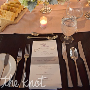 Lauren and Stephen served some of their favorite foods such as mixed greens with crasins, candied walnuts and gorgonzola, pumpkin risotto and mini carrot cake cupcakes for dessert. The menu acted as a menu and a place card with the guests' name typed on the bellyband.
