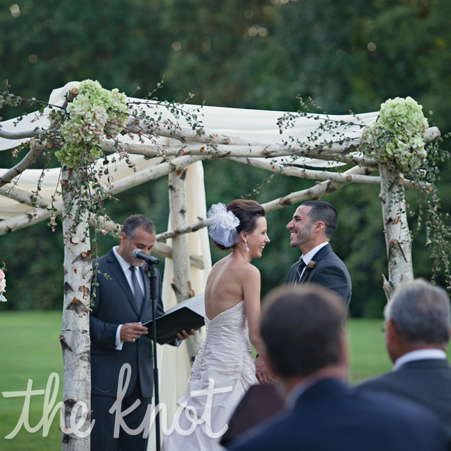 The ceremony took place outside of the Highlands Country Club right on the golf course. The all birch canopy was created on-site and it was draped in soft chiffon with hydrangeas and other greenery.