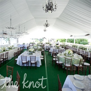 Ashley and Grant held their reception outside under a tent that had been draped with white fabric and decked out with Tuscan-style chandeliers.