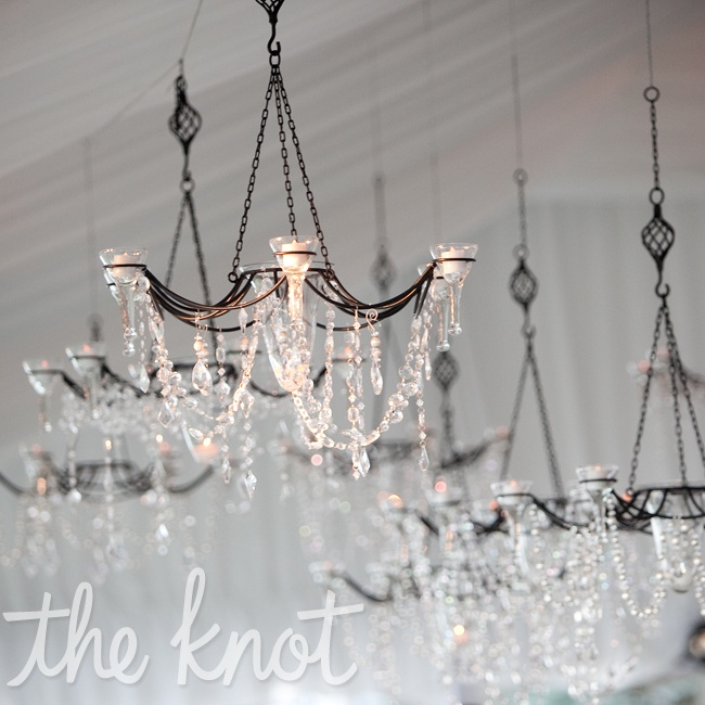 The tent was decorated with wrought iron chandeliers and candles.