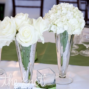White roses and hydrangeas adorned the tables.