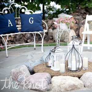 Monogrammed pillows and simple hurricane lanterns and candles created a cozy environment for guests to congregate.