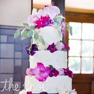 Each of the five tiers was a different flavor. The outside of the cake was finished off with fresh pink flowers.