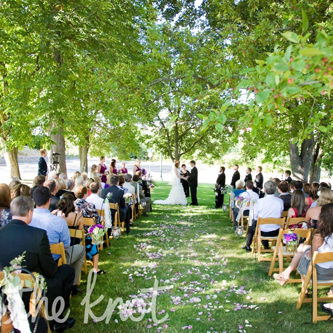 Platt Garden outside the train depot was the perfect spot for their ceremony. Guests sat in simple wooden folding chairs and rose petals were sprinkled down the center aisle.