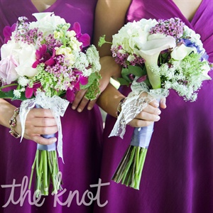The bridesmaid bouquets included orchid, roses,and lilies.