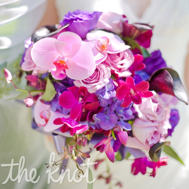 Megan's bouquet was filled with a variation of orchids, roses and lilies.