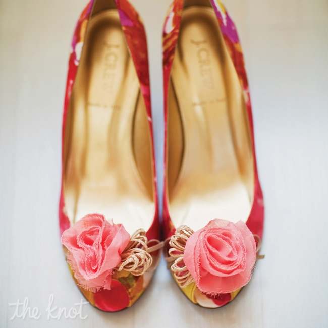 Lizz wore these pretty, colorful peep-toe heels with floral poms on the ends.