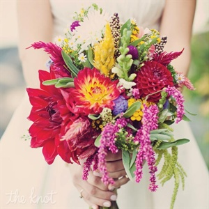 Lizz carried a bright bouquet of red, pink and yellow flowers along with various herbs for aroma.