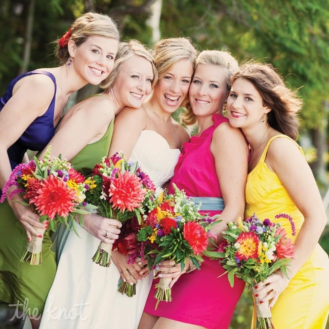 The bridesmaids carried bright bunches similar to Lizz's bouquet.
