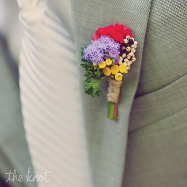 The guys wore small purple, red and yellow blooms on their lapels.