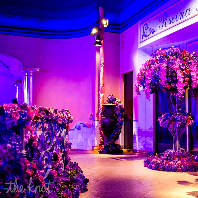 "You don't hire Preston unless you love flowers,"" Blum says. Eye-catching floral displays dominated the décor, starting with the two-tiered pedestal overflowing with pink and purple flowers that greeted guests at the rehearsal party."