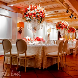 "At the reception, tall coral centerpieces dripping in crystals stole the show. ""It was a perfect mix of over-the-top and tasteful elegance,"" Blum says."