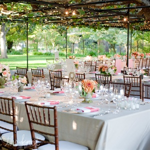 The couple chose khaki linen table cloths and white napkins with a pink/coral border.  They placed the menus in the napkin fold for a clean presentation.