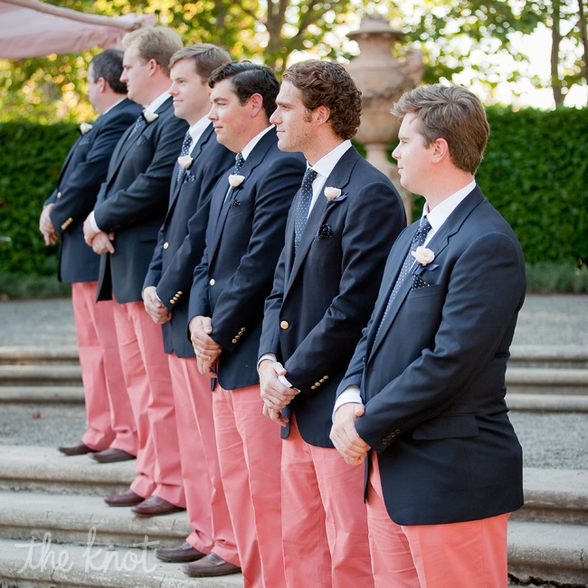 The men (including both the bride and groom's fathers) wore navy blazers, white shirts and brown loafers from their own closets paired with coral flat-front pants. Ross also worked with Team One Newport to create custom sailing vests for his groomsmen as a thank-you for being part of the big weekend.