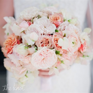 Lauren designed a beautiful, lush textured bouquet of coral, papaya and pink tones.  The bouquet included parrot tulips, garden roses, ranuculus and clusters of sweet peas finished with a ribbon.