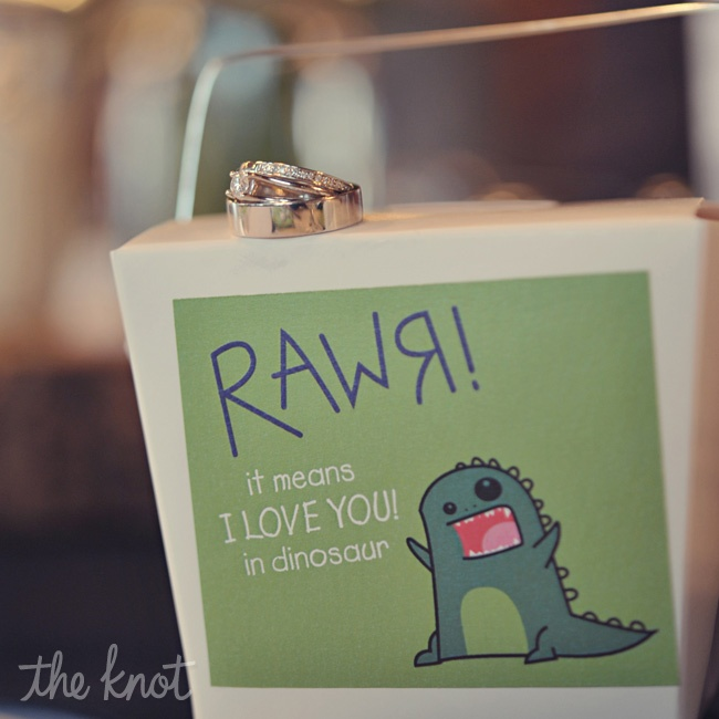 "For the couple's favors they wanted to use 5cent candy because when they first started dating it was common for them to get 5cent candies and sit at the beach. They put the candy inside of Chinese style take out boxes decorated with a sticker of ""Rawr means I love you in dinosaur"" - a sentiment Laura loved!"
