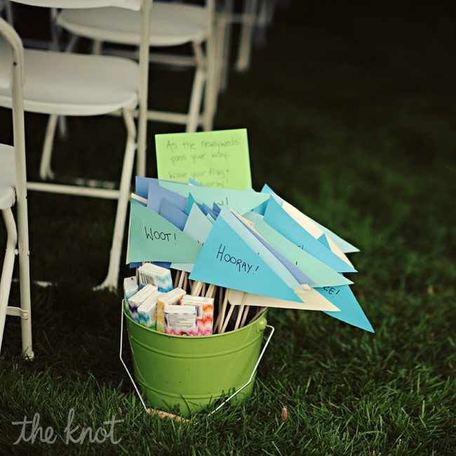 The couple had a bright green bucket with signs made by the bride saying things like: yippee, woot, hooray and rawr for people to wave after the couple was pronounced husband and wife. There were also some Kleenex in the bucket for their guests to take just in case!