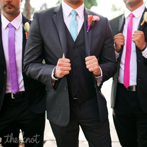 The groomsmen wore black suits with the tie that matched their bridesmaid: lime green, fuchsia, or purple.