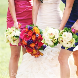 All the bridesmaids had all white flowers to contrast their bright dresses. Connie had a colorful bouquet in contrast to her white gown.