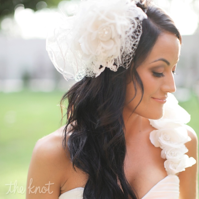 Connie wore her hair all to one side with loose curls to accent the one strap of her dress and her custom head piece which was in lieu of a vail.  It had lace, crystals, a bow centerpiece and birdcage edges.