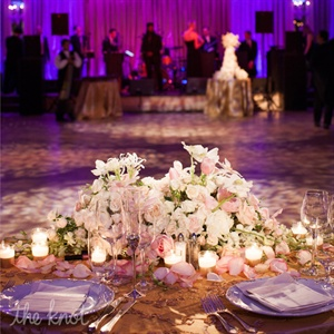 Centerpieces contained hydrangeas, garden roses, dendrobium orchids and Dutch tulips, whose petals 