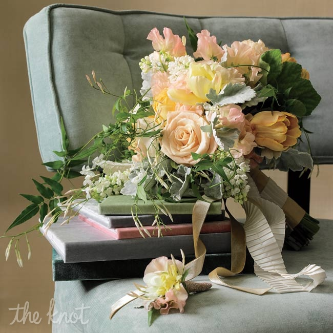 Play with contrasting styles for a more interesting look. An organic bouquet of pastel blooms will soften a glam ball gown. Dusty miller and jasmine vine keep this romantic mix of roses, sweet peas and white lilacs from feeling too sweet.
