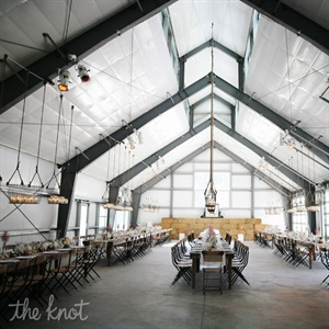 While the décor was simple, the couple's personality came out in so many ways: from the foodie menu and the coasters that mimicked those from the restaurant where Jen and Ken had their first date to the unique chandeliers—antique lobster baskets (a nod to the seafood restaurant the pair owns)—filled with jars of candles.
