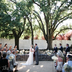 The couple exchanged vows they wrote to each other and the groom's children under a giant oak tree. A close family friend, 