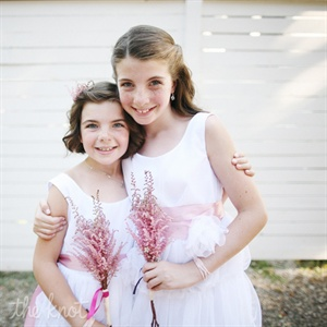 Jen added a personalized touch to each flower girls (Kens daughters) pink bouquet: tiny butterflies for one bunch and a purple ribbon for the other.